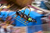 Teenagers Enjoy A Flying Carnival Ride With Motion Blur