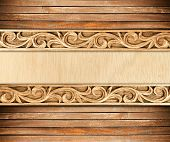 stock photo of carving  - Pattern of wood frame carve flower on wood background - JPG