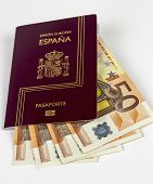 picture of spanish money  - Spanish Passport with 50 curency euro on white background - JPG