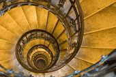 picture of spiral staircase  - Spiral staircase forged handhold and stone steps in old tower - JPG
