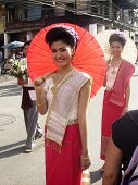 Thai Lady With Umbrella In Floral Festival In Chiang Mia Nth Thailand