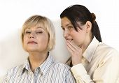 stock photo of chatterbox  - Two women gossiping and discussing hot news - JPG
