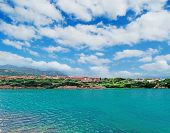 Emerald Water And Clouds