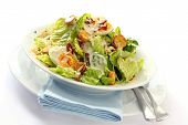 stock photo of caesar salad  - Caesar salad in a white bowl with blue napkin - JPG