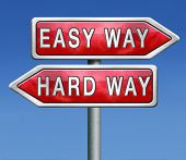 easy way and hard way roadsign arrow on blue background crossroads decisive choice challenge making