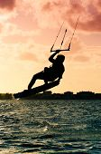 Silhouette Of A Kitesurfer Flying