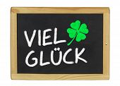 Viel Glueck (Good Luck) on a blackboard on a white background