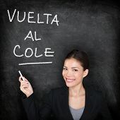 Vuelta al cole - Spanish teacher woman. Back to School written in Spanish on blackboard by female on