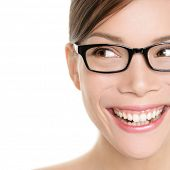 Woman wearing glasses looking happy to side. Eyewear woman with big smile wearing eyeglasses. Close