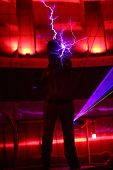 MOSCOW - FEBRUARY 8: Man holds lightning at presentation of attraction Megavolt - master of lightnin