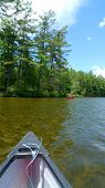 stock photo of potash  - Canoe trip in lake with blue sky