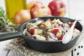 foto of liver fry  - Chicken liver stewed with apples and onion in the frying pan - JPG