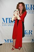 LOS ANGELES - DECEMBER 05: Mallory Tarcher and Lamb Chop at the Presentation of