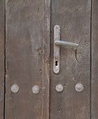 Wooden old door with handle