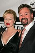 HOLLYWOOD - DECEMBER 07: Traci Lords and Howard Fine at Howard Fine's Ball of Fire December 07, 2006 in Boardners, Hollywood, CA.