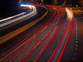 Headlight And Taillight Trails On A Busy Highway At Night