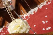 stock photo of pews  - Flowers and pearls on the pews  lining the aisle at a wedding venue - JPG