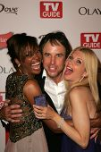 HOLLYWOOD - AUGUST 27: Aisha Tyler with Kevin Nealon and Susan Yeagley at the TV Guide Emmy After Party at Social August 27, 2006 in Hollywood, CA.