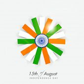 stock photo of indian independence day  - Beautiful flower design in Indian national flag colors with ashoka wheel on grey background  for 15th of August - JPG