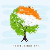 Beautiful tree with Indian trio colors leaves on blue background for 15th of August, Indian Independence Day celebrations.