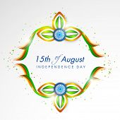 stock photo of ashoka  - Shiny flower design in national flag colors with ashoka wheel on grey background for 15th of August - JPG