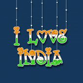 Hanging stylish text I Love India in Indian National Flag colors on blue background for Indian Indep