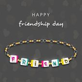 Beautiful friendship band on grey background for Happy Friendship Day celebrations.
