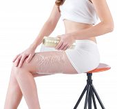 woman wrapping her leg by plastic wrapper
