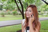 Attractive young redhead Asian woman on her mobile