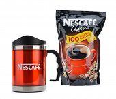 Ankara, Turkey - April 12, 2013: Promotional red Nescafe mug isolated on white background.