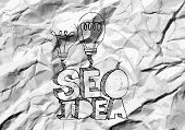 Seo Idea SEO Search Engine Optimization on crumpled paper