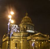Cathedral Of Saint Isaac And Christmas Garland On Street Lamp, St. Petersburg