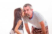 Daughter Whispering Secret In Dad's Ear
