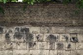 pic of old stone fence  - Background of old tiled fence from stone and brick - JPG