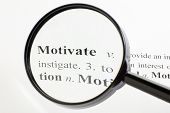 stock photo of pronunciation  - The word motivate seen through a magnifying glass - JPG