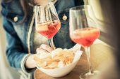 Young women enjoying their aperitif