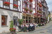 Bernkastel, Germany - Jul 21: Historic Center Of Medieval City Bernkastel With Unknown Tourists Sitt