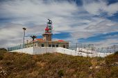 pic of lagos  - Ponta de Piedade Lighthouse overlooking the Atlantic Ocean Lagos Algarve Portugal - JPG