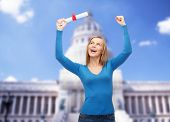 university and education concept - smiling woman with diploma