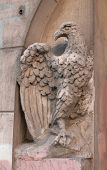 Detail Of Entrance To House Decorated With A Sculpture An Eagle