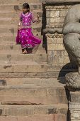 Child  With Traditional Dress Going Down The Stairs Of Nyatapola Temple