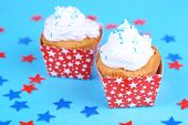 American patriotic holiday cupcakes on blue background
