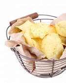 Tasty potato chips in metal basket, isolated on white