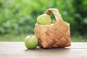 Apples In Wicker Basket On Table
