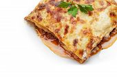 stock photo of lasagna  - hot freshly made home lasagna with white copy space