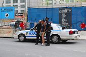 NYPD Police Officers taking picture with tourist near World Trade Center  in Manhattan