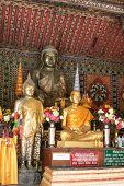 Buddha And Monk Statue In Wat Phra Kaow Don Tao Su Da Cha Ram In Lampang