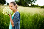 stock photo of elderflower  - Young woman picking elderflower to make an infusion at home - JPG