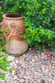 picture of sluts  - Pottery bowl decorated with river rocks in the garden - JPG