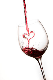 foto of wine-glass  - Pouring a heart of red wine in a glass white background - JPG